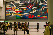 "Interior of Shibuya train Station in Tokyo, Japan a mural by Taro Okamoto, ""The Myth of Tomorrow"" in the background"