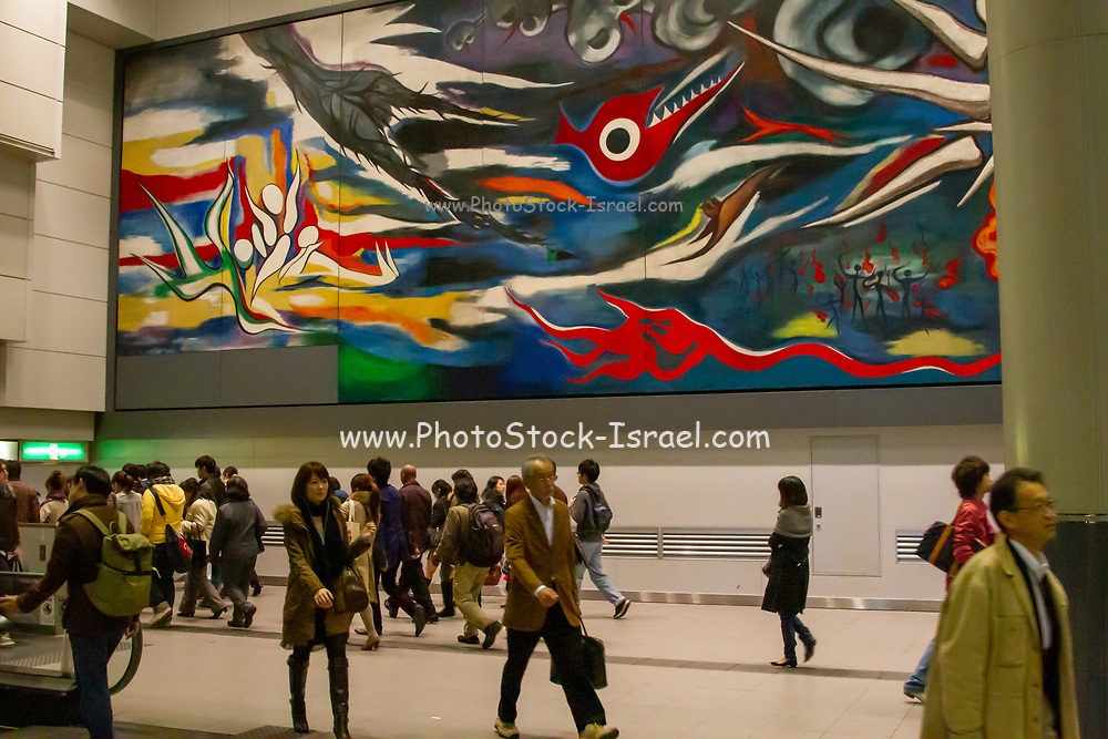 """Interior of Shibuya train Station in Tokyo, Japan a mural by Taro Okamoto, """"The Myth of Tomorrow"""" in the background"""