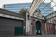 An urban landscape of closed businesses in the former Smithfield meat market that is awaiting future redevelopment, on 20th November 2019, at Smithfield in the City of London, England. In March 2015, the Museum of London revealed plans to vacate its Barbican site and move into the General Market Building. The cost of the move is estimated to be in the region of £70 million and, if funding can be achieved, would be complete by 2021. There has been a market on this location since the Bartholomew Fair was established in 1133 by Augustinian friars.