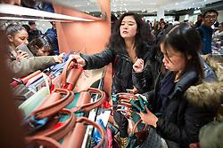 © Licensed to London News Pictures . 26/12/2015 . Manchester , UK . Bargain hunters scooping up handbags in the Selfridges winter sale . Photo credit: Joel Goodman/LNP
