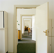 Corridor of offices photographed in a local government finance office in Berlin , taken on the 28th of February 2008.<br />  From the series Desk Job, a project which explores globalisation through office life around the World.