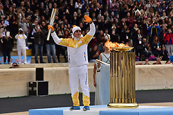 October 31, 2017 - Athens, Attiki, Greece - Last Torchbearer Ioannis Proios after lighting the cauldron. The Handover Ceremony of the Olympic Flame for Winter Games PYEONGCHANG 2018, took place today in Panathenaic Stadium in the presence of the President of Hellenic Republic Prokopis Pavlopoulos. (Credit Image: © Dimitrios Karvountzis/Pacific Press via ZUMA Wire)