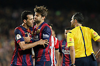 Barcelona´s Pique holds Sergio Busquets while arguing with the referee during 2014-15 Copa del Rey final match between Barcelona and Athletic de Bilbao at Camp Nou stadium in Barcelona, Spain. May 30, 2015. (ALTERPHOTOS/Victor Blanco)