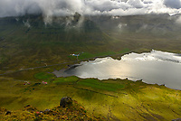 Just as I had hoped, the sun began to break through the clouds while I climbed Kirkjufell.