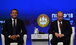 Russian President Vladimir Putin and French President Emmanuel Macron attending a session of the Saint Petersburg International Economic Forum on May 25, 2018 in Saint Petersburg. Photo by Christian Liewig/ABACAPRESS.COM