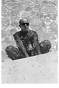 BILLY NORWICH, Cipriani swimming pool. Venice. 1991. <br /> <br /> SUPPLIED FOR ONE-TIME USE ONLY> DO NOT ARCHIVE. © Copyright Photograph by Dafydd Jones 248 Clapham Rd.  London SW90PZ Tel 020 7820 0771 www.dafjones.com