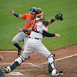 July 23, 2017 - Baltimore, MD, USA - Baltimore Orioles catcher Caleb Joseph, right, is ready to apply tag to put out Houston Astros' Jose Altuve on a fielder's choice in the fifth inning on Sunday, July 23, 2017 at Oriole Park at Camden Yards in Baltimore, Md. The Orioles defeated the Astros, 9-7. (Credit Image: © Kenneth K. Lam/TNS via ZUMA Wire)