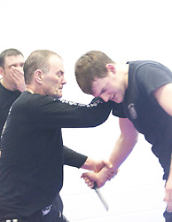 The end of the International Krav Maga Federation (IKMF) Civilian Instructor Course (CIC) part 3 at the Scottish Martial Arts Centre, Alloa. Students take part in knife, gun and stick defence exercises..©2011 Michael Schofield. All Rights Reserved.