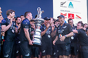 Emirates Team New Zealand celebrate on stage after being presented with the Americas Cup on stage after beating Luna Rossa Prada Pirelli Team 7 - 3.  Wednesday the 17th of March 2021. Copyright photo: Chris Cameron