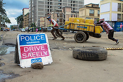 May 8, 2020, Nairobi, Kenya: Kenyan water vendors pass through a police roadblock on Muinami Street, Pumwani during lockdown..On 06 May 2020, the Kenyan government announced a 15-day lockdown order in Eastleigh, Nairobi and the Old town area in the port city of Mombasa over rising cases of COVID-19 in these areas. The lockdown, among other preventative measures, was implemented to curb the spread of the virus. (Credit Image: © Boniface Muthoni/SOPA Images via ZUMA Wire)