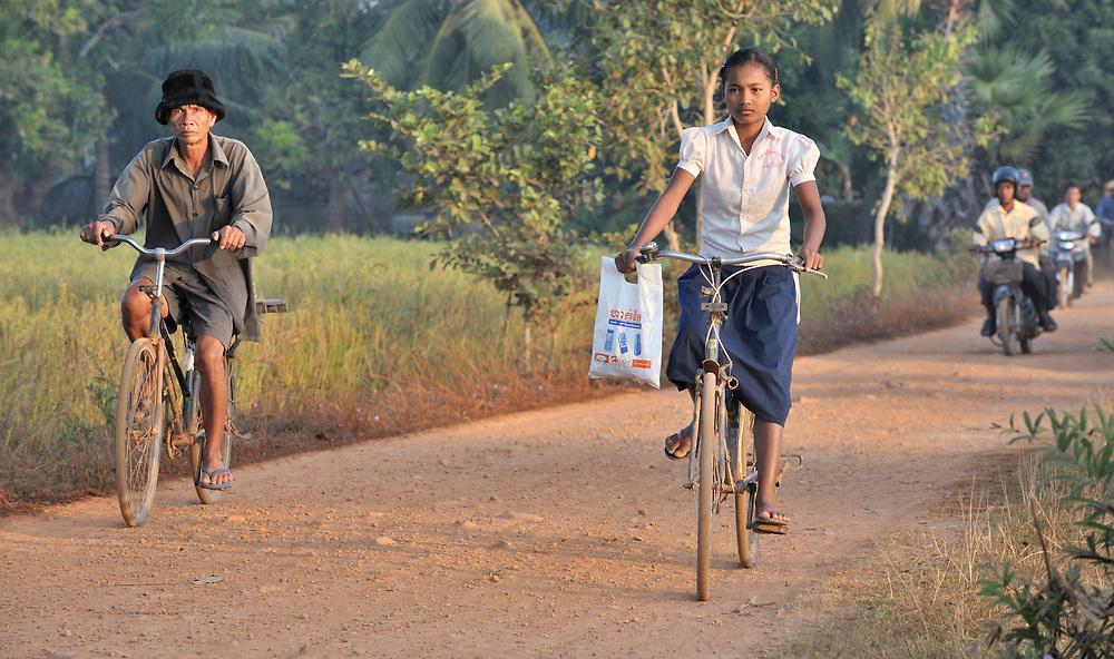 Srey Mao, 14, rides her bike to school in Khnach, a village in the Kampot region of Cambodia.