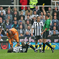 Photo. Andrew Unwin.<br /> Newcastle United v Wolverhampton Wanderers, FA Barclaycard Premier League, St James Park, Newcastle upon Tyne 09/05/2004.<br /> Wolves' Paul Ince (l) receives a yellow card for a challenge that leaves Newcastle's Olivier Bernard (1 from l) on the floor in agony.