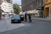 Policeman and policewoman cycling the streets of Innsbruck, Austria