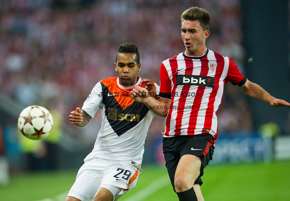BILBAO, SPAIN - SEPTEMBER 17:  Aimeric Laporte of Athletic Club Bilbao duels for the ball with Alex Teixeira of Shakhtar Donetsk during the UEFA Champions League Group H match between Athletic Club and Shakhtar DonetskÊat San Mames Stadium on September 17, 2014 in Bilbao, Spain. Ê  (Photo by Juan Manuel Serrano Arce/Getty Images)