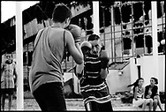 The boxing club practices outside the destroyed sports complex in Pristina, Kosovo.