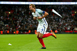 Harry Kane of England celebrates scoring the winning goal to make it 1-0 as a paper plane is thrown from the crowd - Mandatory by-line: Robbie Stephenson/JMP - 05/10/2017 - FOOTBALL - Wembley Stadium - London, United Kingdom - England v Slovenia - World Cup qualifier