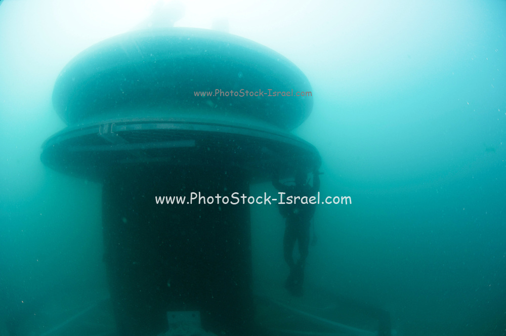 """Israel, Hadera, underwater photography of the installation work of the offshore suction head for the desalinization plant. The facility will produce 127 Million m3 per a year and will be operated in the """"reveres osmosis"""" technique. Commercial Diver installing zinc block to reduce erosion"""