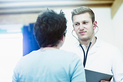 Mature patient talking to young doctor in a hospital, Freiburg Im Baden-Württemberg, Germany