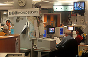 1990s staff of the BBC work at the broadcaster's World Service station, 21st June 2018, in London, England. The BBC World Service occupied four wings of the building. Broadcasting from Bush House lasted for 70 years, from winter 1941 to summer 2012. Sections of Bush House were completed and opened over a period of 10 years: Centre Block was opened in 1925, North-West Wing in 1928, North-East Wing in 1929, South-East Wing in 1930, and South-West Wing in 1935. The full building complex was completed in 1935. (Photo by Richard Baker / In Pictures via Getty Images)