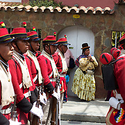"""An indigenous Bolivian lady watches the Bolivian soldiers of the historic Colorados battalion participate in a military parade to honor national hero Eduardo Avaroa as part of """"Day of the Sea"""" celebrations. Bolivia lost its coastline 131 years ago to Chile in the """"Guerra del Pacifico"""", or War of the Pacific.  Sopocachi, La Paz, Bolivia,  March 23, 2010."""