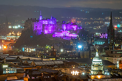 Edinburgh, Scotland, UK. 27 January 2020. Edinburgh Castle is illuminated in purple tonight light as the world marks Holocaust Memorial Day ( HMD). Iain Masterton/Alamy Live News