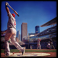 iPhone Instagram of Albert Pujols of the Los Angeles Angels warming up on-deck with Mike Trout up to bat against the Minnesota Twins at Target Field in Minneapolis, Minnesota on September 7, 2014
