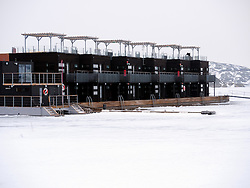 View of modern floating hotel called Salt and Sill in traditional village of Kladesholmen during winter on Bohuslan coast in Sweden