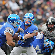 Air Force quarterback Kale Pearson hands off to running back Jacobi  Owens,  during the Army Black Knights Vs Air Force Falcons, College Football match at Michie Stadium, West Point. New York. Air Force won the game 23-6. West Point, New York, USA. 1st November 2014. Photo Tim Clayton