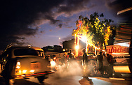 The bustle and noise of Ootacamund's market street fails to eclipse a small Tamil religious procession making its way to the temple.