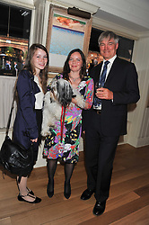 RICHARD & JILL BROADBENT, their daughter HANNAH and their dog Jodie at the 10th anniversary of George in association with The Dog's Trust held at George, 87-88 Mount Street, Mayfair, London on 13th September 2011.