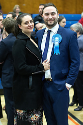 © Licensed to London News Pictures . 13/12/2019. Bury, UK. CHRISTIAN WAKEFORD poses with his wife ALEXANDRA (l) as they celebrate the Conservative Party's win in Bury South , at the count for seats in the constituencies of Bury North and Bury South in the 2019 UK General Election , at Castle Leisure Centre in Bury . Photo credit: Joel Goodman/LNP