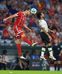 MUNICH, GERMANY - Tuesday, August 1, 2017: Liverpool's Mohamed Salah (right) and FC Bayern Munich's Javi Martinez (left) during the Audi Cup 2017 match between FC Bayern Munich and Liverpool FC at the Allianz Arena. (Pic by David Rawcliffe/Propaganda)