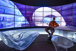 """© Licensed to London News Pictures. 17/10/2019. LONDON, UK. A model sits within a design by Hassell, 2019, of a full scale model of a Mars habitat. Preview of """"Moving to Mars"""" at the Design Museum. The exhibition explores how sending humans to Mars is a frontier for science as well as design and features over 200 exhibits from NASA, the European Space Agency together with new commissions.  The show is open 18 October to 23 February 2020.  Photo credit: Stephen Chung/LNP"""