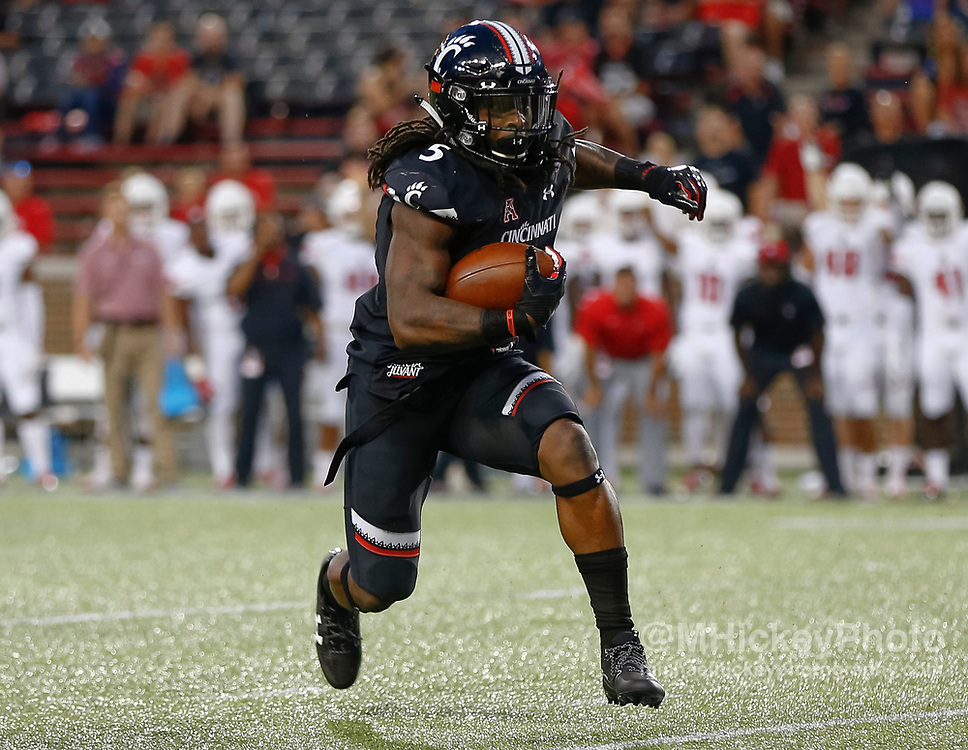 CINCINNATI, OH - AUGUST 31: Mike Boone #5 of the Cincinnati Bearcats runs the ball against the Austin Peay Governors at Nippert Stadium on August 31, 2017 in Cincinnati, Ohio. (Photo by Michael Hickey/Getty Images)  *** Local Caption *** Mike Boone