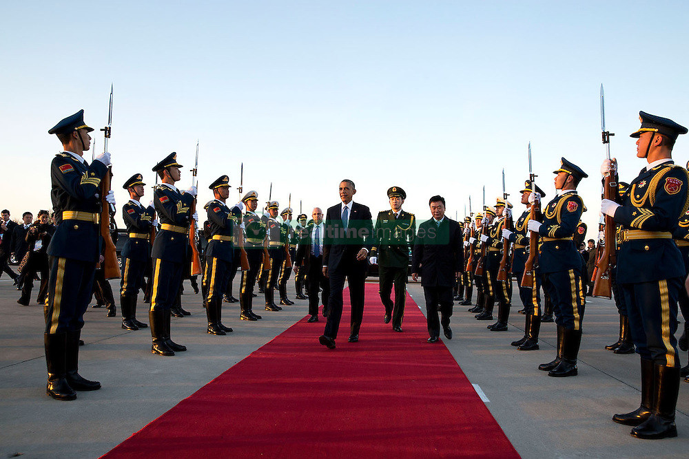 President Barack Obama is escorted to Air Force One by Foreign Minister Wang Yi at Beijing Capital International Airport, prior to departure from Beijing, China en route to Burma, Nov. 12, 2014. (Official White House Photo by Pete Souza)<br /> <br /> This official White House photograph is being made available only for publication by news organizations and/or for personal use printing by the subject(s) of the photograph. The photograph may not be manipulated in any way and may not be used in commercial or political materials, advertisements, emails, products, promotions that in any way suggests approval or endorsement of the President, the First Family, or the White House.