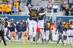 Nov 14, 2020; Morgantown, West Virginia, USA; West Virginia Mountaineers safety Tykee Smith (23) intercepts a pass and then celebrates with wide receiver Winston Wright Jr. (16) and wide receiver T.J. Simmons (1) during the fourth quarter against the TCU Horned Frogs at Mountaineer Field at Milan Puskar Stadium. Mandatory Credit: Ben Queen-USA TODAY Sports