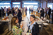 Azenith Smith of FOX 2 KTVU (left) and Jan Half of MOUSE Squad Student Tech share ideas during the Silicon Valley Business Journal's HHaaS Tech Mixer at ZERO1 in San Jose, California, on May 28, 2015. (Stan Olszewski/SOSKIphoto for the Silicon Valley Business Journal)