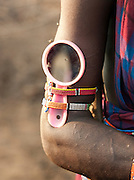 Maasai tribesman with a beauty mirror strapped to his arm, Tipilit village near Amboseli National Park, Kenya