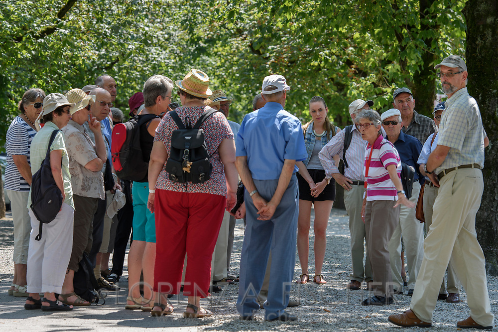 A group of people is attending to a guided tour of the town of Frauenfeld on nice and hot summer afternoon in July, Thurgau, Switzerland