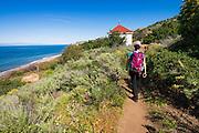 Hiker above Prisoner's Harbor, Santa Cruz Island, Channel Islands National Park, California USA