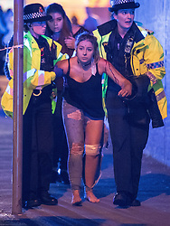 May 22, 2017 - Manchester, England, United Kingdom - An injured concert-goer is helped by police and emergency responders at the Manchester Arena after reports of an explosion. Manchester police reported 'a number of confirmed fatalities and others injured' as hundreds of fans fled the arena. (Credit Image: © Joel Goodman/London News Pictures via ZUMA Wire)