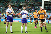 Assistant referee James Quinn with referee Graham Cooper and Tom Cusack. NSW Waratahs v ACT Brumbies. 2021 Super Rugby AU Round 7 Match. Played at Sydney Cricket Ground on Friday 2 April 2021. Photo Clay Cross / photosport.nz