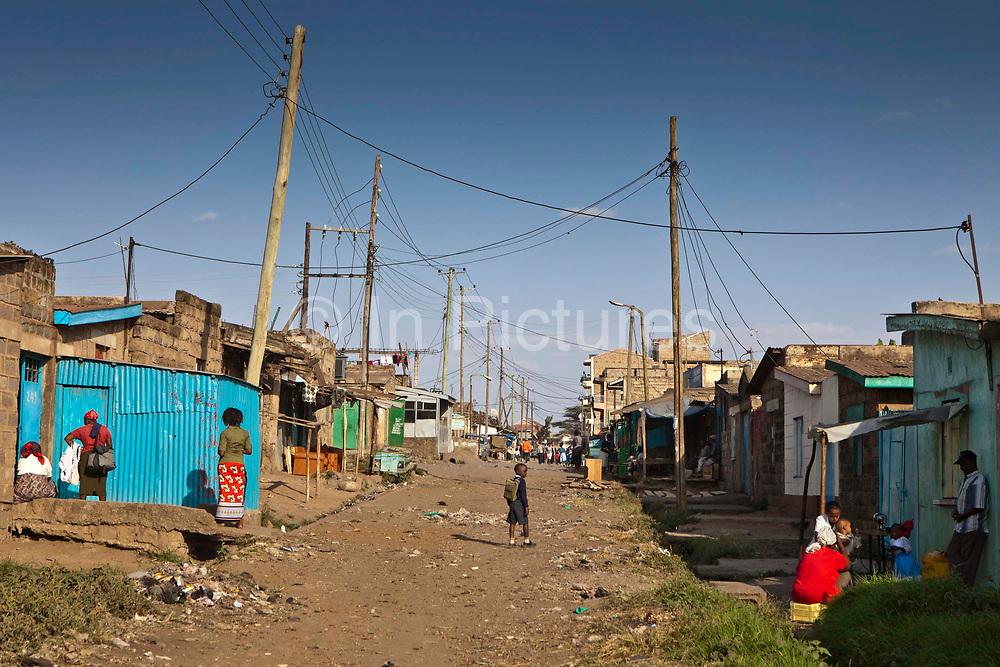 A street scene from Dandora slum, Nairobi, Kenya. Undugu Society of Kenya (USK), an NGO who run various programmes in the area and at local schools.