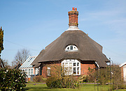 Unusual round thatched cottage at Easton village, Suffolk, England