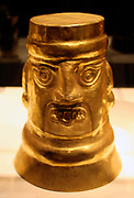 Inverse-Face Beaker.  Peru Sican (Lambayeque) 9th-11th century. Hammered gold. The large gold Sican beakers are astonighing not only because of their great size but also because of their numbers.  Many dozens of them have been found in single tombs.