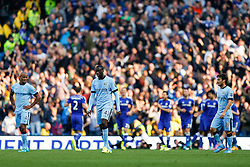 Vincent Kompany and Yaya Toure of Manchester City look dejected Andre Schurrle of Chelsea scores the opening goal of the game - Photo mandatory by-line: Rogan Thomson/JMP - 07966 386802 - 21/08/2014 - SPORT - FOOTBALL - Manchester, England - Etihad Stadium - Manchester City v Chelsea FC - Barclays Premier League.