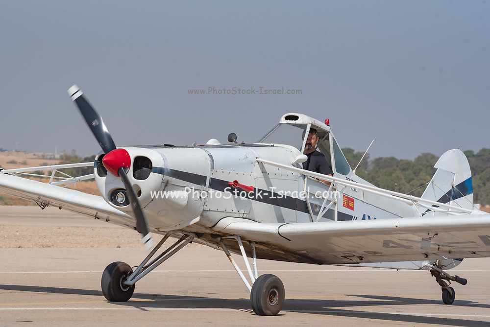 Pilot in a single seat turboprop airplane ready for takeoff