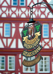 Old wine shop sign in Bernkastel-Kues village on River Mosel in Mosel valley in Germany
