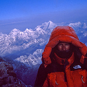 Conrad Anker at 28,200 foot Mushroom Rock on the Northeast Ridge of Mount Everest on May 17, 1999, as he prepares for his first attempt to free climb the Second Step.