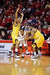 05 December 2009: Lloyd Phillips can't collect the foul when wiggling his way to freedom from a trap set by William McClure and Amir Rashid. The Chippewas of Central Michigan are defeated by the Redbirds of Illinois State 75-62 on Doug Collins Court inside Redbird Arena in Normal Illinois.